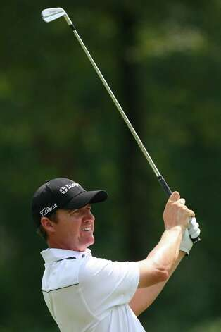 Jimmy Walker hits his second shot on the 18th hole during the second round of the Wyndham Championship at Sedgefield Country Club  on Aug. 17, 2012 in Greensboro, N.C. Photo: Hunter Martin, Getty Images / 2012 Getty Images