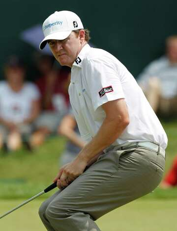 Jimmy Walker reacts to a missed birdie putt on the 18th green during the third round of the Greenbrier Classic golf tournament at the Greenbrier in White Sulphur Springs, W. Va., Saturday, July 30, 2011. Walker shot an 8-under, 62 to leave him at 7-under-par for the three rounds. Photo: Steve Helber, Associated Press / AP