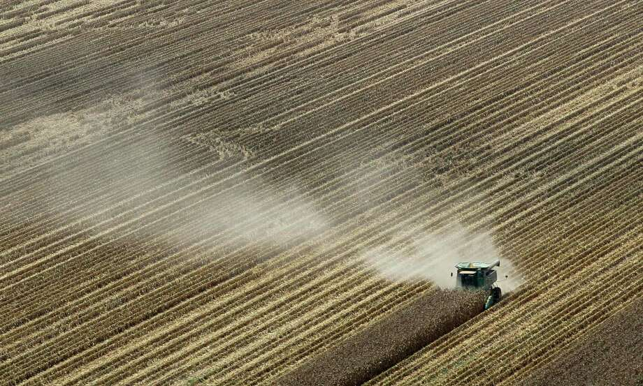 Dust is carried by the wind last August near Coy, Ark. Widespread drought and a mostly absent winter pushed the average annual U.S. temperature last year up to 55.32 degrees, up a full degree. Photo: Danny Johnston, STF / AP