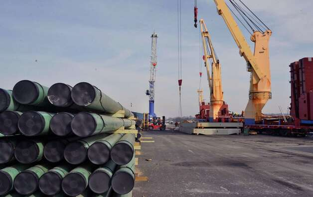Gas pipe, left, ready to be loaded aboard the BBC Houston bound for Saudi Arabia at the Port of Albany Tuesday Jan. 8, 2013. (John Carl D'Annibale / Times Union) Photo: John Carl D'Annibale / 00020689A