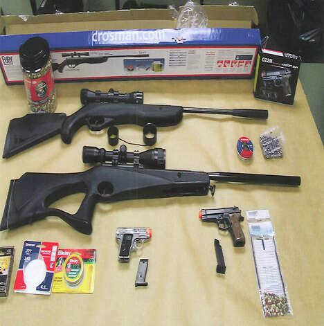Stratford, Conn. police display air guns and pellet rifles seized from four men who were arrested outside of Wooster Middle School on Jan. 8, 2012. Photo: Contributed Photo