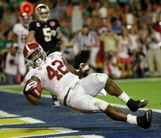Discover BCS National Championship, Jan. 7: Alabama 42, Notre Dame 14; Sun Life Stadium in Miami; Payout: $18,000,000 PHOTO: Alabama's Eddie Lacy falls into the end zone for a touchdown during the first half of the BCS National Championship against Notre Dame. Photo: David J. Phillip, Associated Press / AP