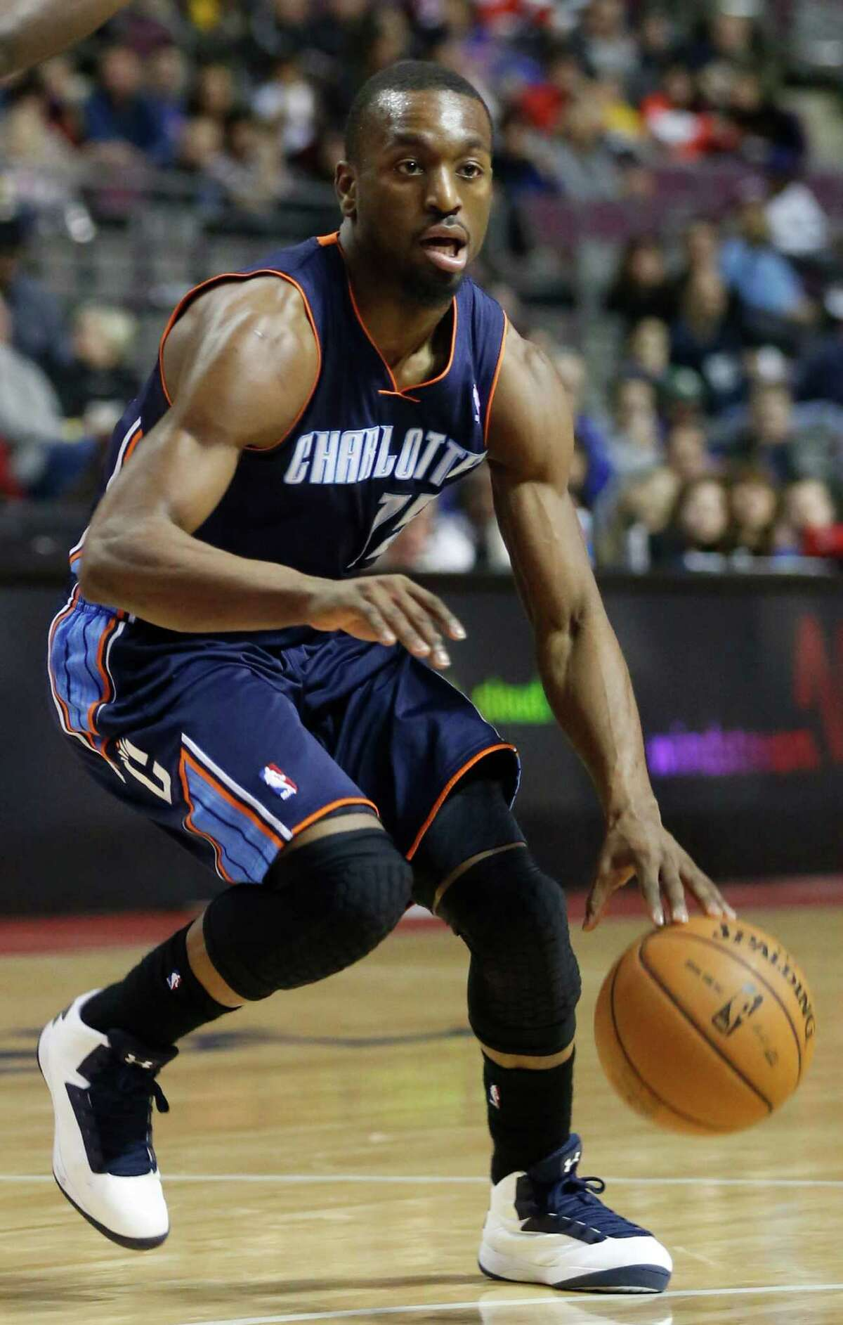 Charlotte Bobcats guard Kemba Walker (15) against the Detroit Pistons in the first half of an NBA basketball game Sunday, Jan. 6, 2013, in Auburn Hills, Mich. (AP Photo/Duane Burleson)