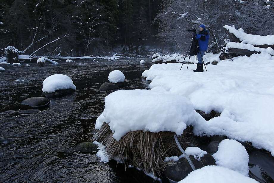 Photographer Lance Trott of San Jose records the Yosemite Valley winter. The National Park Service plans to restore habitat, increase campsites and parking places and cut some recreational activities. Photo: Michael Macor, The Chronicle