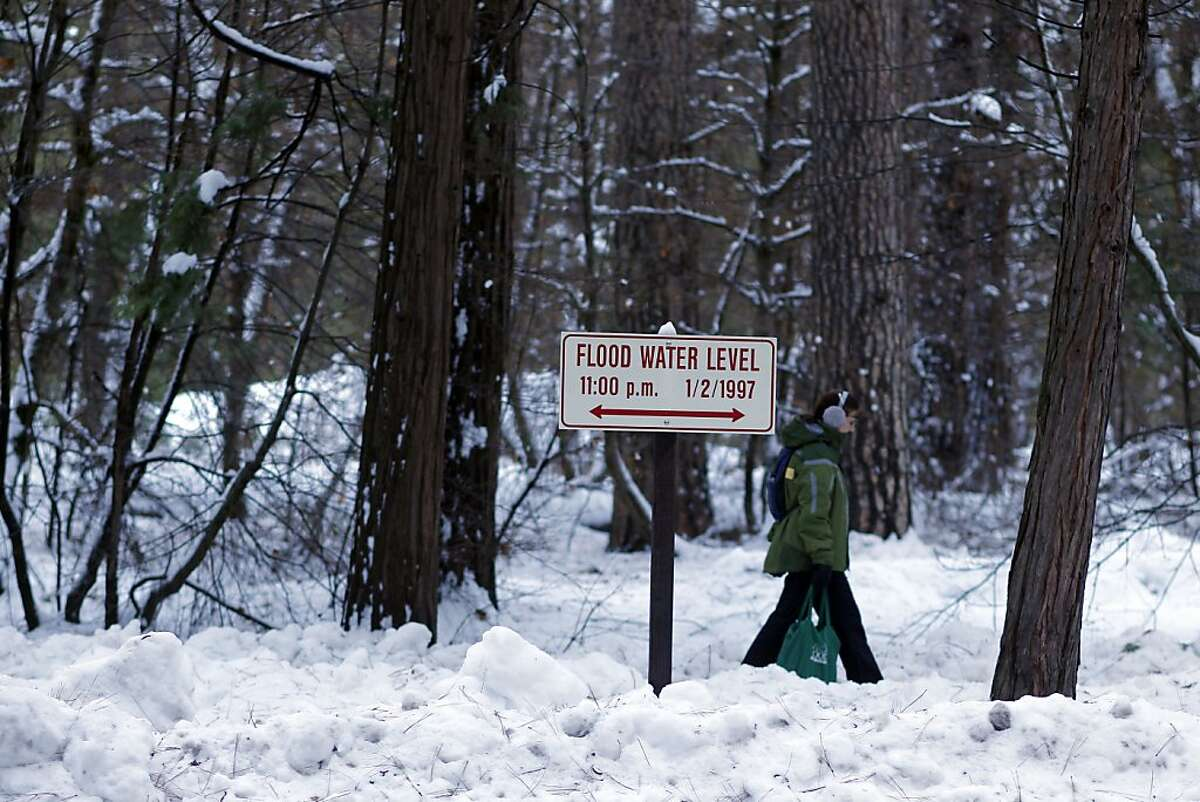 A sign shows the water level of the 1997 floods, in Yosemite Valley, Calif., on Tuesday Jan. 8, 2013, at Upper River campgrounds across the street from Lower River campgrounds where 350 campsites were wiped out during the flood. The park service is proposing opening 32 sites in the area, which has been closed since the flood. Yosemite National Park announced today the release of two Wild and Scenic River comprehensive Management Plan Draft Environmental Impact Statements for the Merced River and the Tuolumne River for public review and comment.