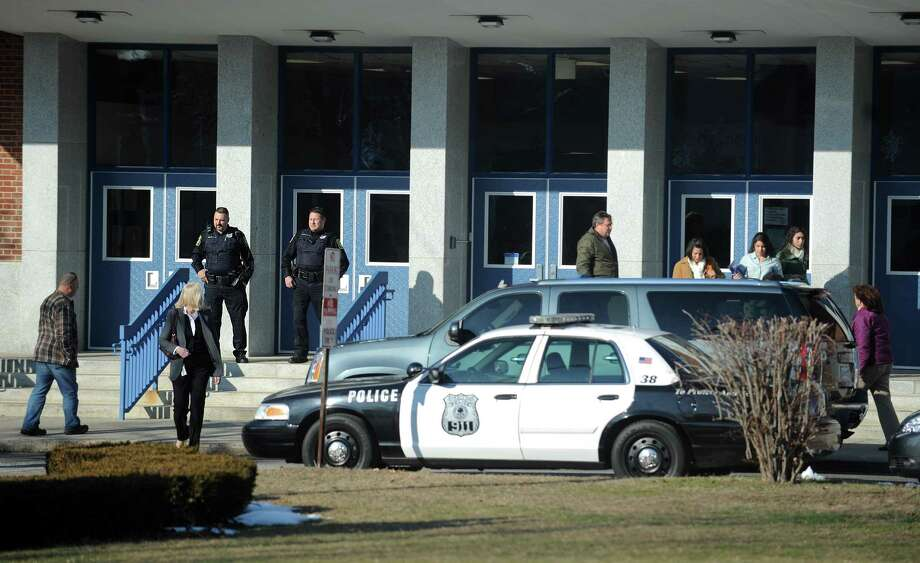 Wooster Middle School in Stratford, Conn. was in lockdown briefly Tuesday, Jan. 8, 2013 while authorities apprehended four men, two carrying what are believed to be hi-powered pellet rifles in the woods behind the school. Photo: Autumn Driscoll / Connecticut Post