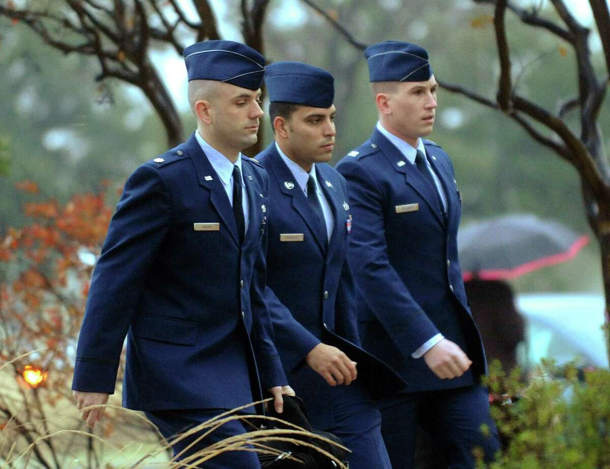 Air Force Tech. Sgt. Jaime Rodriguez, middle, who is accused of rape, forcible sodomy and adultery while assigned to the Lake Jackson recruiting office from August 2008 to November 2011, arrives for an evidentiary hearing at Joint Base San Antonio-Lackland on Tuesday morning, Jan. 8, 2013.