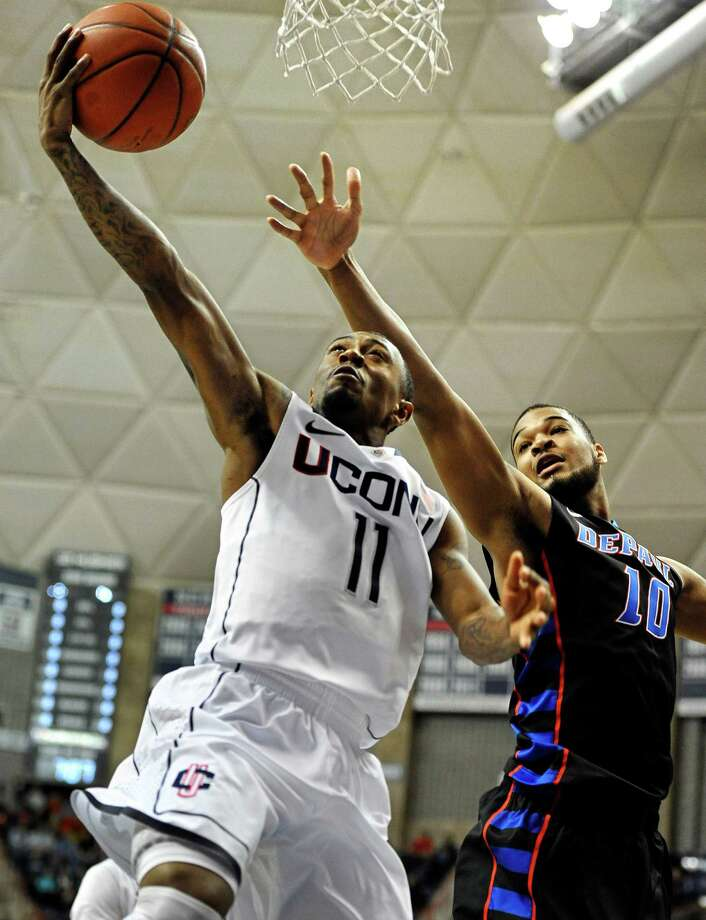 Connecticut's Ryan Boatright (11) goes up for a basket while guarded by DePaul's Derrell Robertson Jr. (10) during the first half of an NCAA college basketball game in Storrs, Conn., Tuesday, Jan. 8, 2013. (AP Photo/Jessica Hill) Photo: Jessica Hill, Associated Press / FR125654 AP