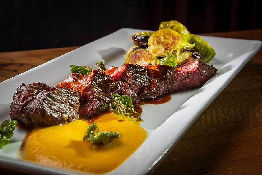 Odalisque in San Rafael offers familiar choices such as bavette steak with Brussels sprouts, above, and more interesting options such as lamb tagine, below. Photo: John Storey, Special To The Chronicle