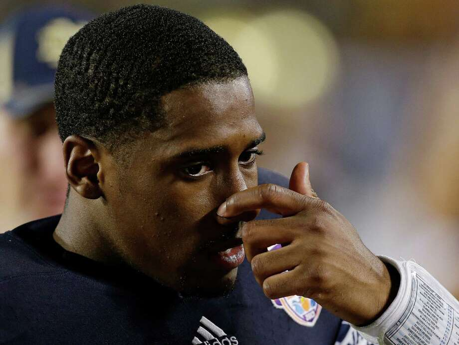 Notre Dame quarterback Everett Golson is seen on the bench near the end of the BCS National Championship college football game Monday, Jan. 7, 2013, in Miami. Alabama won 42-14. (AP Photo/Chris O'Meara) Photo: Chris O'Meara