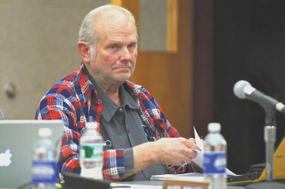 Ravena-Coeymans-Selkirk school board member Rodney Krzykowski listens to a speaker during a board meeting at the high school library on Tuesday night Feb. 28, 2012 in Ravena, N.Y.  (Philip Kamrass / Times Union ) Photo: Philip Kamrass