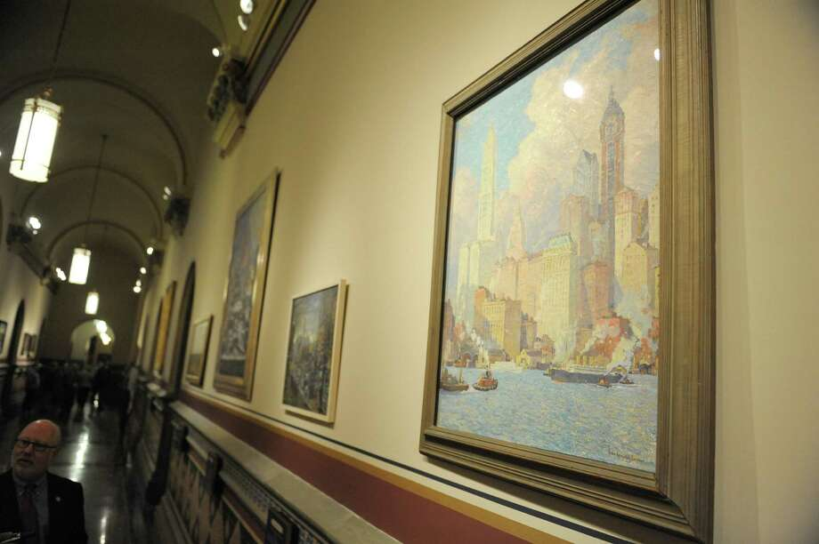 The painting entitled Hudson River Waterfront, New York by Colin Campbell Cooper, an oil on canvas painting ca. 1902-1921is seen hanging on the wall in the new Hall of New York on the second floor of the Capitol on Tuesday, Jan. 8, 2013 in Albany, NY.  The hall will be an exhibit space where landscapes devoted to regions of New York will be displayed.  (Paul Buckowski / Times Union) Photo: Paul Buckowski  / 00020700A