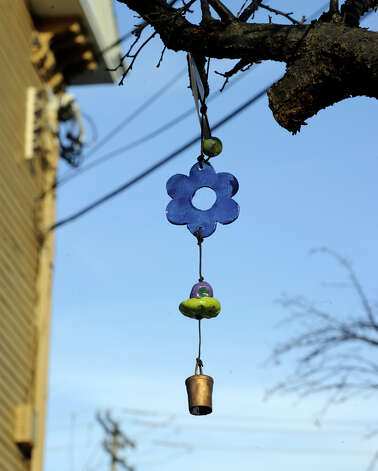 A Tucson, Arizona group, Ben's Bells has come to Newtown to hang, with the help of local volunteers, over 1000 ceramic bells in as a way of remembering the grief of the Sandy Hook shootings. Photo: Carol Kaliff / The News-Times