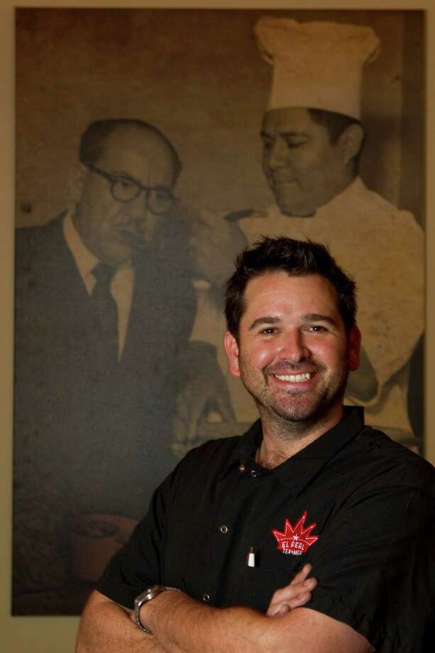 Much of the Westheimer restaurant's furniture and memorabilia moved across the street, to El Real Tex-Mex. In this 2011 photo, chef Bryan Caswell poses with his favorite photo of Tijerina, shown tasting one of his chef's dishes. Photo: Melissa Phillip, Staff / Houston Chronicle