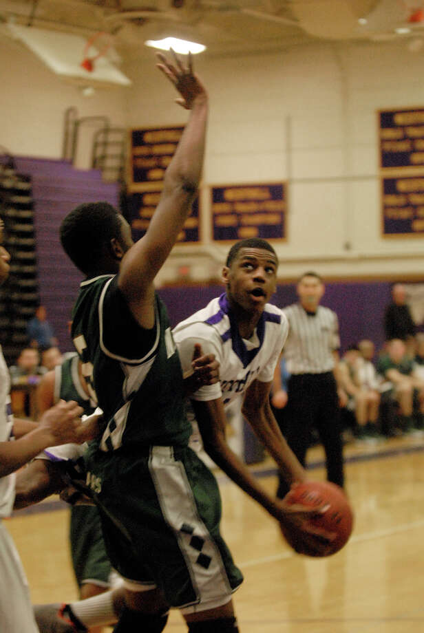 Westhill's Jeremiah Livingston looks to get the ball around Norwalk's Zaire Wilson as Westhill High School hosts Norwalk in a boys basketball game in Stamford, Conn., Jan. 8. 2013. Photo: Keelin Daly / Stamford Advocate Riverbend Stamford, CT