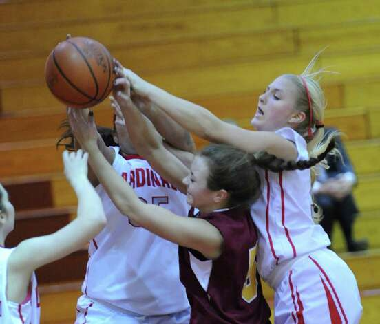At right, Rebecca DeCarlo of Greenwich goes over the top of Lauren Della Vecchia of St. Joseph for a rebound during girls high school basketball game between Greenwich and St. Joseph at Greenwich High School, Tuesday night, Jan. 8, 2013. Photo: Bob Luckey / Greenwich Time
