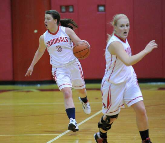 At left, Caroline Barrett # 3 of Greenwich advances the ball during the girls high school basketball game between Greenwich and St. Joseph at Greenwich High School, Tuesday night, Jan. 8, 2013. Photo: Bob Luckey / Greenwich Time