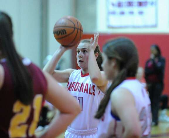 Alexa Moses # 11 of Greenwich attempts a foul shot during girls high school basketball game between Greenwich and St. Joseph at Greenwich High School, Tuesday night, Jan. 8, 2013. Photo: Bob Luckey / Greenwich Time