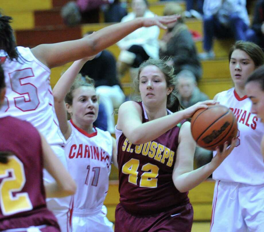 (10) Bridget Sharnick #42 of St. Joseph. In a game against Darien earlier this season, Sharnick pulled off the strong double-double, scoring 18 points and hauling in 14 rebounds in the win over the Blue Wave. Photo: Bob Luckey / Greenwich Time