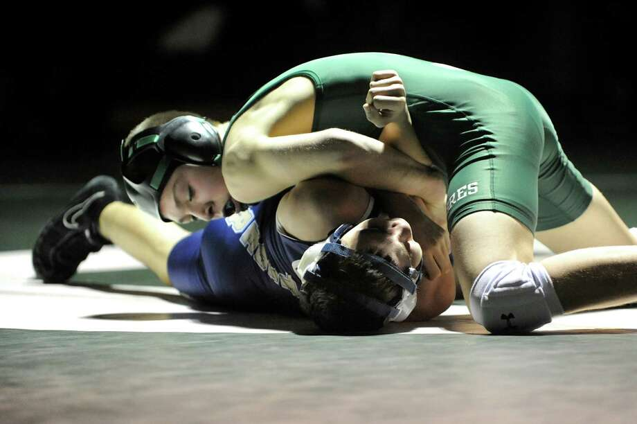 Schalmont's Kyle Jasenski, top, grapples with Cohoes' C.J. Warner at 106 pounds during their wrestling match on Thursday, Jan. 3, 2013, at Schalmont High in Rotterdam, N.Y. (Cindy Schultz / Times Union) Photo: Cindy Schultz / 00020648A