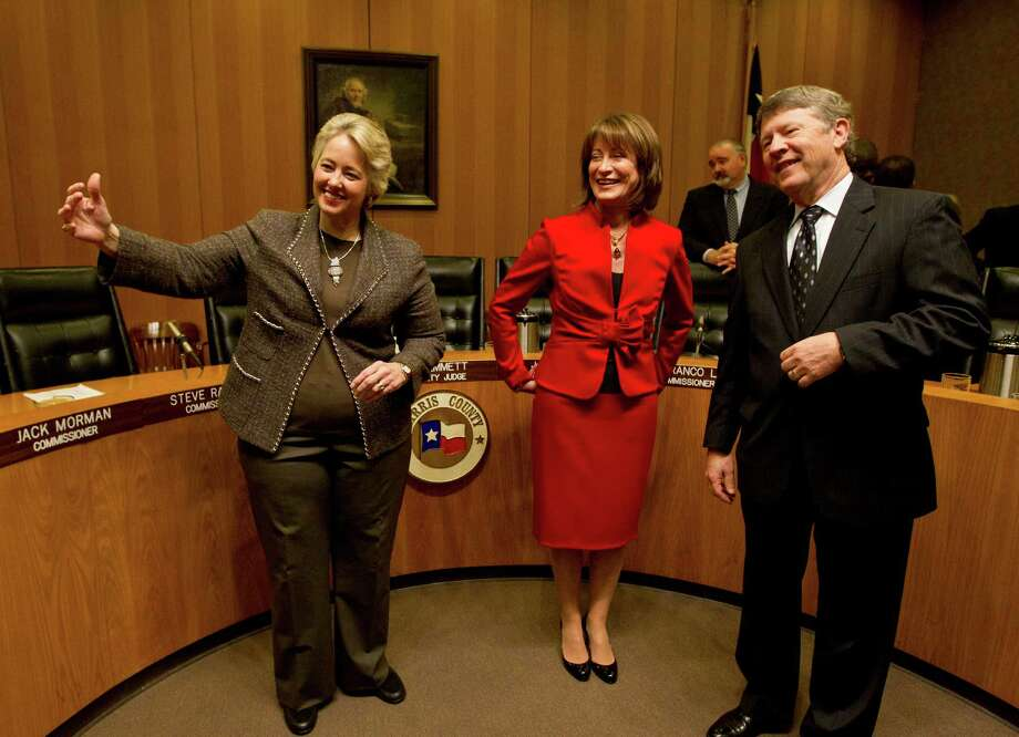 Mayor Annise Parker motions for Janiece Longoria's husband, Steve Lasher, to come and be photographed with his wife and Judge Ed Emmett on Tuesday after Longoria was voted in as chair of the Port of Houston, Photo: Karen Warren, Staff / © 2013 Houston Chronicle