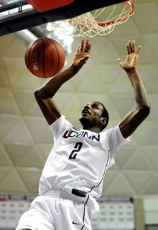 Connecticut's DeAndre Daniels (2) dunks the ball during the second half of an NCAA college basketball game against DePaul in Storrs, Conn., Tuesday, Jan. 8, 2013. Connecticut won 99-78. (AP Photo/Jessica Hill) Photo: Jessica Hill, Associated Press / FR125654 AP
