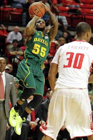 Baylor's Pierre Jackson (55) shoots over Texas Tech's Jaye Crockett (30) during their NCAA college basketball game in Lubbock, Texas, Tuesday, Jan. 8, 2013. (AP Photo/The Avalanche-Journal, Zach Long) ALL LOCAL TV OUT Photo: Zach Long, Associated Press / The Avalanche-Journal