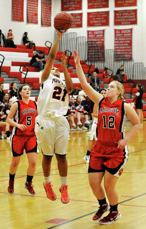 Pomperaug's Gabbie Holness shoots over Masuk's Amy Rajpolt during their game at Pomperaug High School in Southbury on Tuesday, Jan. 8, 2013. Pomperaug won, 60-38. Photo: Jason Rearick / The News-Times