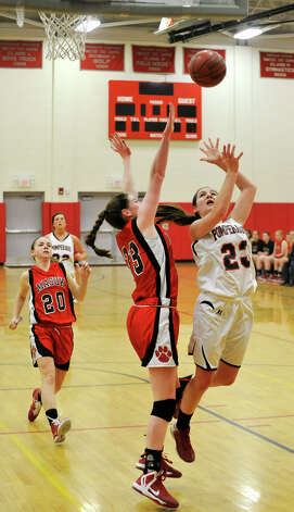Pomperaug's Katelyn Perrotti shoots over Masuk's Danielle Adams during their game at Pomperaug High School in Southbury on Tuesday, Jan. 8, 2013. Pomperaug won, 60-38. Photo: Jason Rearick / The News-Times