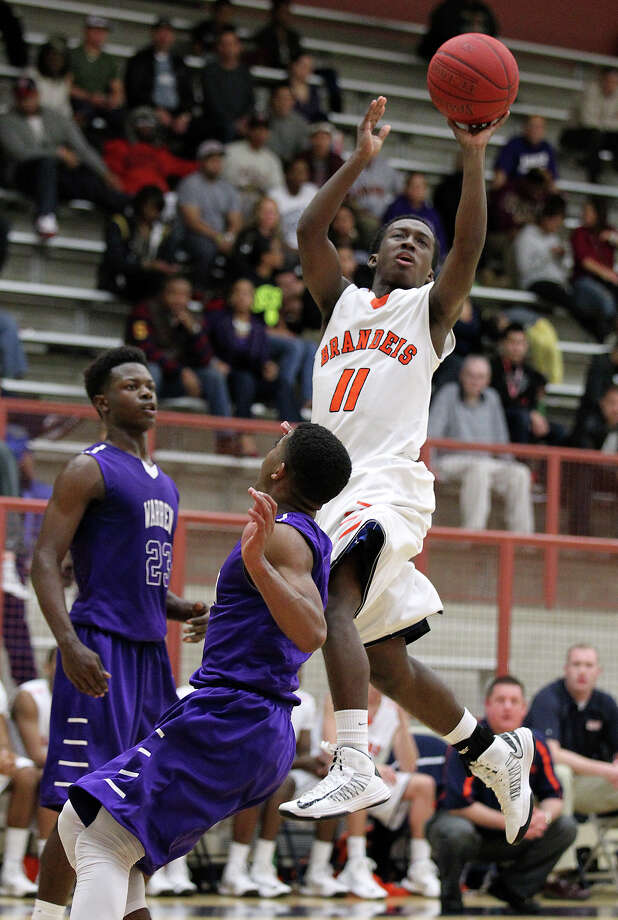 Brandeis' Chris Starkes attempts a shot over Warren's Marcus Keene on Tuesday night at O'Connor High School. Top-ranked Brandeis defeated No. 6 Warren 56-48. Photo: Kin Man Hui, San Antonio Express-News / © 2012 San Antonio Express-News