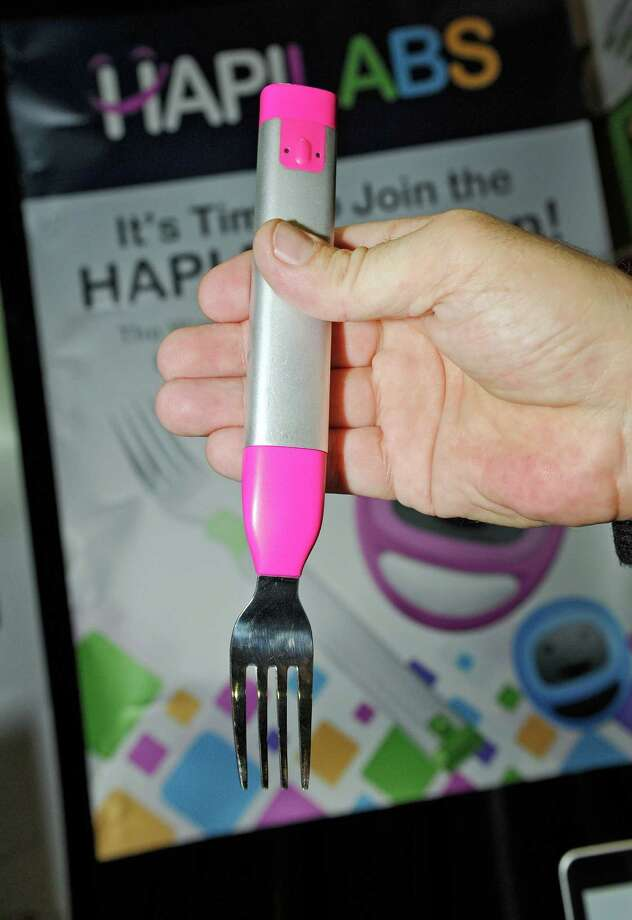 The Hapifork, which costs $99, vibrates to let you know when you're speeding through your meal. It also sends data to a mobile phone app so you can keep track of your eating habits. Photo: David Becker, Stringer / 2013 Getty Images