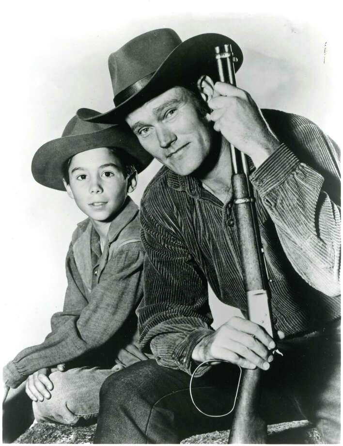 """Johnny Crawford (left) with his """"The Rifleman"""" co-star, Chuck Connors, who was one of a dozen men to play Major League Baseball and in the NBA. Photo: ABC"""