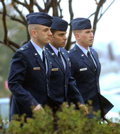 Air Force Tech. Sgt. Jaime Rodriguez, center, arrives for an evidentiary hearing Tuesday at Joint Base San Antonio-Lackland. Eight witnesses took the stand to testify in the hearing, which continues today and could lead to a court-martial. Photo: Billy Calzada, Staff / SAN ANTONIO EXPRESS-NEWS