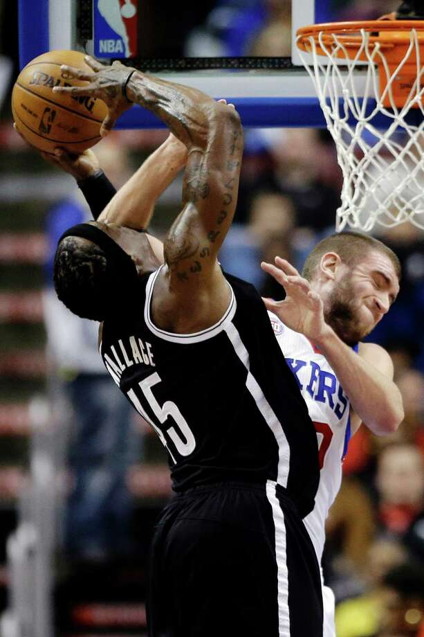 Brooklyn Nets' Gerald Wallace, left, is fouled by Philadelphia 76ers' Spencer Hawes in the second half of an NBA basketball game, Tuesday, Jan. 8, 2013, in Philadelphia. Brooklyn won 109-89. (AP Photo/Matt Slocum) Photo: Matt Slocum