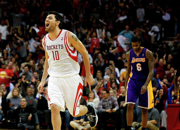 Jan. 8: Rockets 125, Lakers 112Rockets forward Carlos Delfino celebrates after making a 3-pointer during the fourth quarter. Photo: Johnny Hanson / © 2012  Houston Chronicle