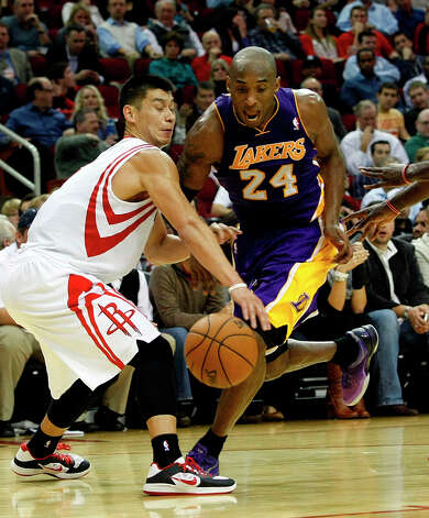 Rockets guard Jeremy Lin defends Kobe Bryant of the Lakers. Photo: Johnny Hanson / © 2012  Houston Chronicle