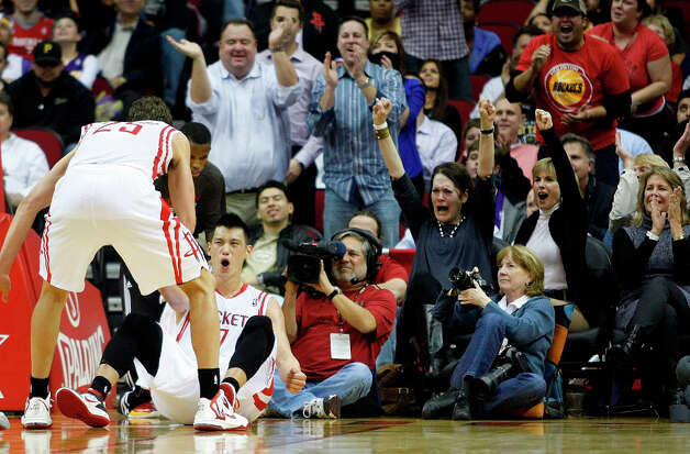 Rockets point guard Jeremy Lin celebrates making a basket while being fouled in the fourth quarter. Photo: Johnny Hanson / © 2012  Houston Chronicle