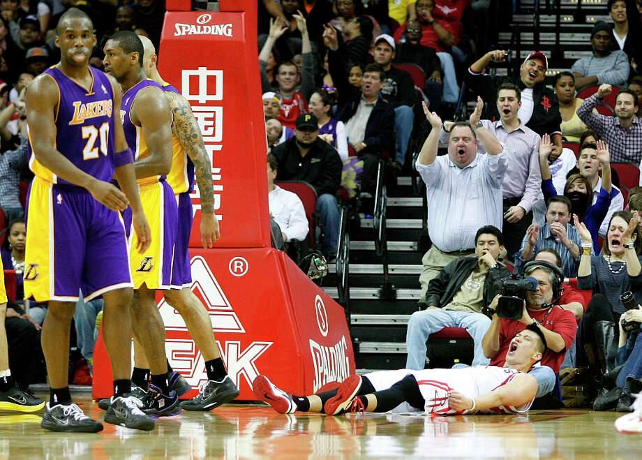 Rockets guard Jeremy Lin shows some emotion after making a layup with contact against the Lakers. Photo: Johnny Hanson / © 2012  Houston Chronicle