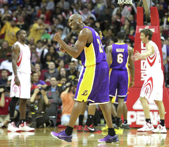 Lakers shooting guard Kobe Bryant reacts after making a basket with a foul during the first quarter. Photo: Johnny Hanson / © 2012  Houston Chronicle