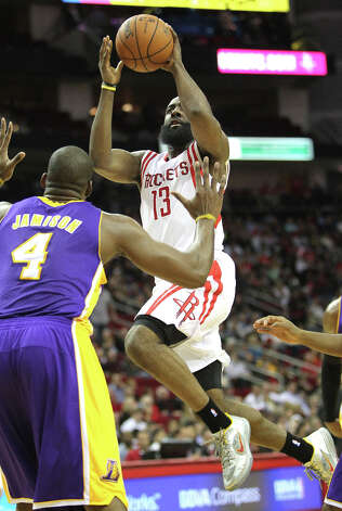 Rockets shooting guard James Harden attempts a shot over Lakers forward Antawn Jamison during the first quarter. Photo: Johnny Hanson / © 2012  Houston Chronicle