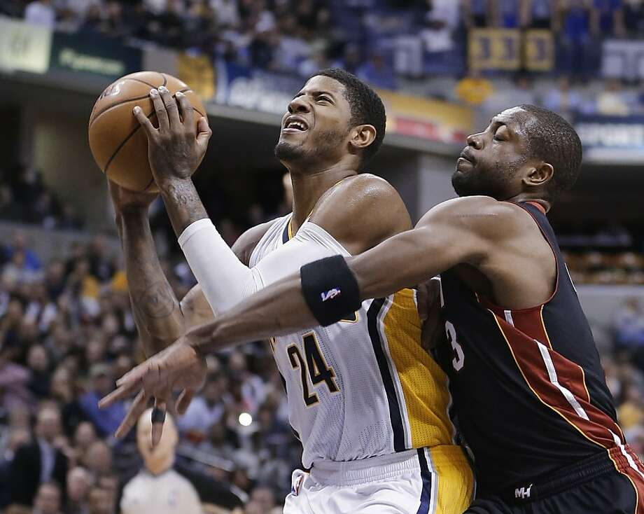 Paul George (24), going up against Dwyane Wade, has become the Pacers' main option since Danny Granger's knee injury. Photo: Darron Cummings, Associated Press