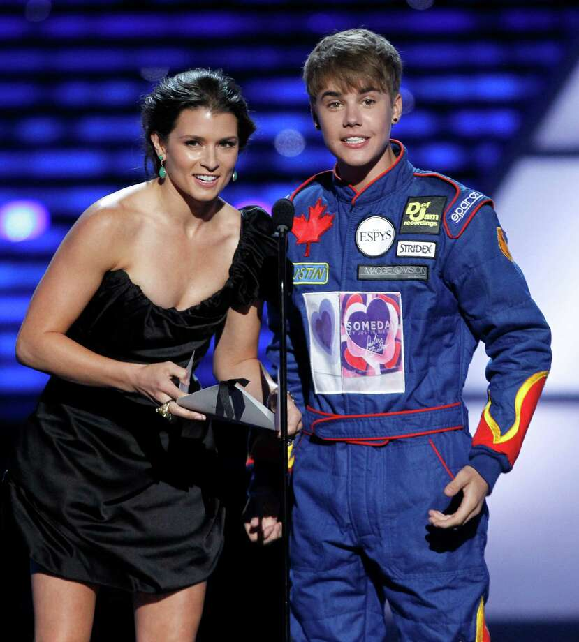 Danica Patrick and Justin Bieber present the award for Best Team at the ESPY Awards on July 13, 2011, in Los Angeles. Photo: Matt Sayles, AP / AP