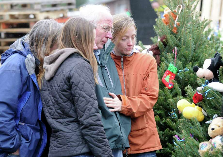 Mourners gathered outside Sandy Hook Elementary School, Sunday Dec. 16, 2012, in Newtown Conn. Twenty-seven people including 20 students were gunned down on Friday. (Will Waldron/Times Union) Photo: Will Waldron