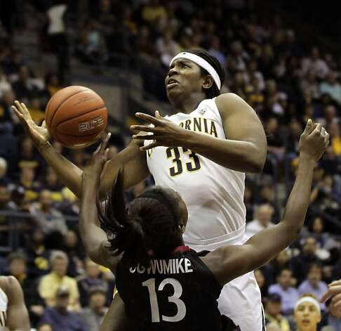 Cal's Talia Caldwell experiences the tough defense of Stanford's Chiney Ogwumike. Photo: Lance Iversen, The Chronicle