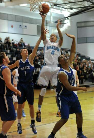 Columbia's Jahlil Nails goes to the basket during their boys high school basketball game against Sha