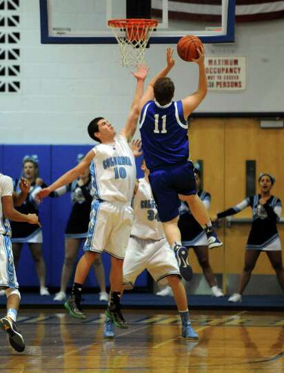 Shaker's tyler Hoffman goes to the basket during their boys high school basketball game against Colu