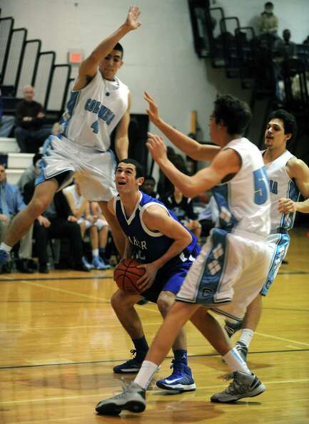 Shaker's Chris Landers goes to the basket during their boys high school basketball game against Colu