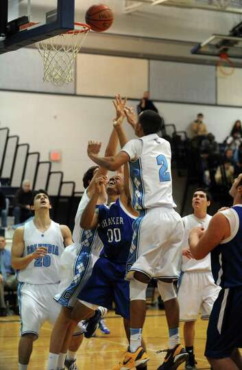 Shaker's Malik Dare goes to the basket during their boys high school basketball game against Columbi