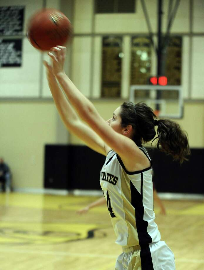 Vidor player Blair Richmond, #14, puts it up for three during the Vidor High School Lady Pirates basketball game against the Central High School Lady Jaguars on Tuesday, January 8, 2013 at Vidor High School. Vidor won over Central 65 - 60. Photo taken: Randy Edwards/The Enterprise Photo: Randy Edwards