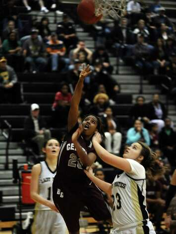 Central player Talitha Savoy, #20 is fouled by Amber Jacks, #23, during the Vidor High School Lady Pirates basketball game against the Central High School Lady Jaguars on Tuesday, January 8, 2013 at Vidor High School. Vidor won over Central 65 - 60. Photo taken: Randy Edwards/The Enterprise Photo: Randy Edwards